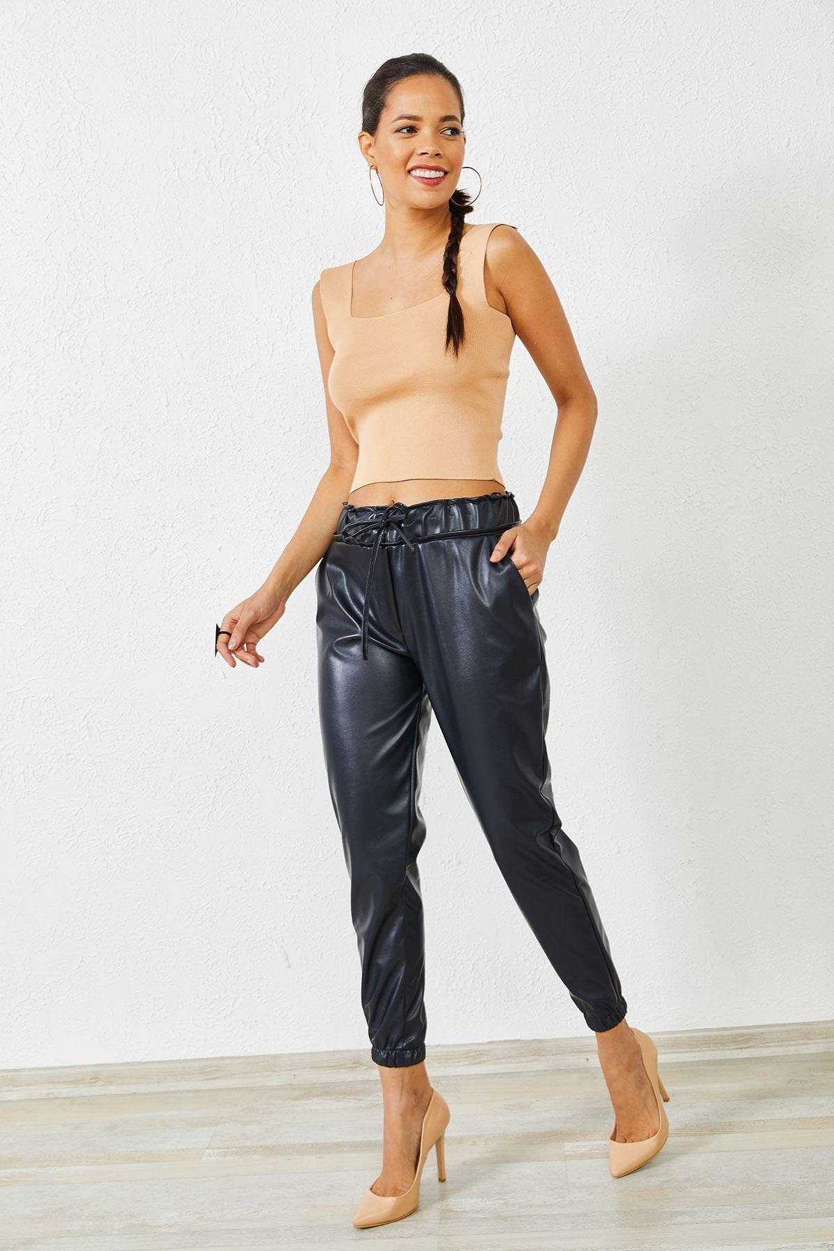 Kadın Bel ve Paça Lastikli Lacivert Deri Pantolon
