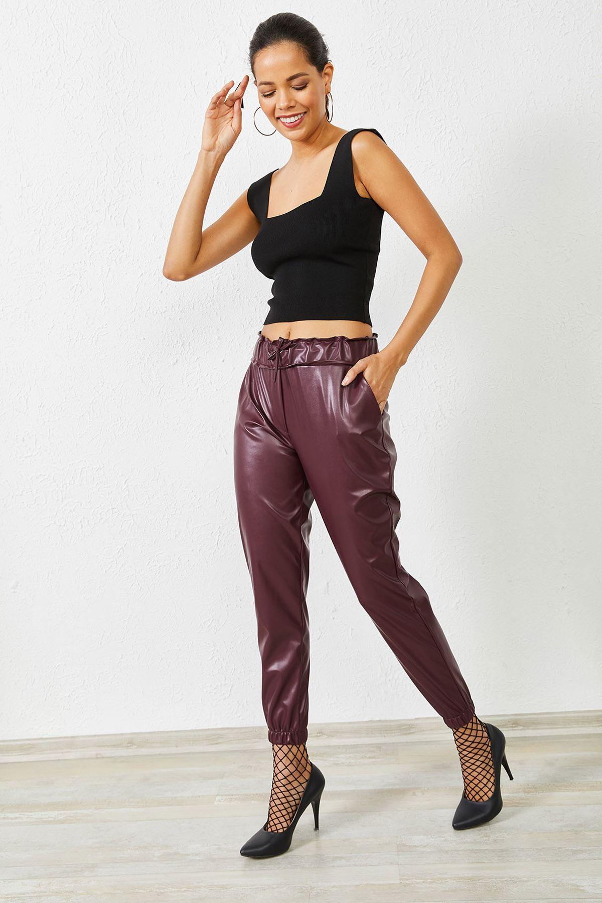 Kadın Bel ve Paça Lastikli Bordo Deri Pantolon